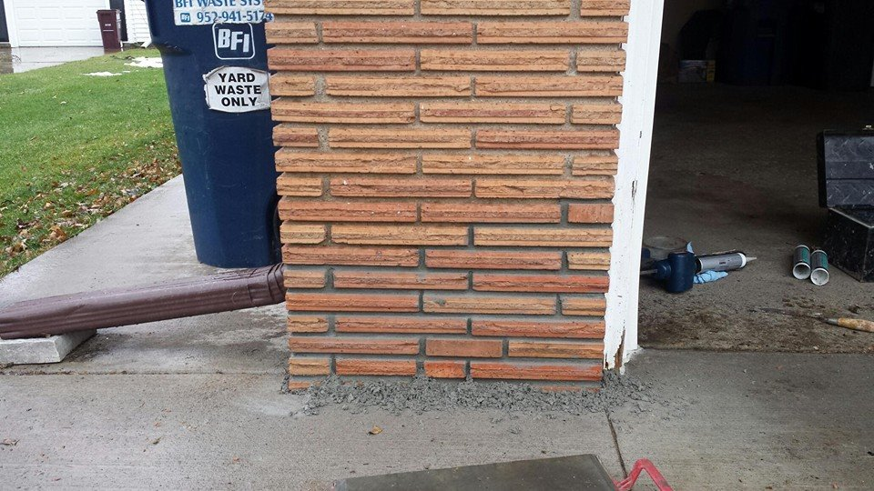 Reconstructed failing brick pier with new and salvaged brick.